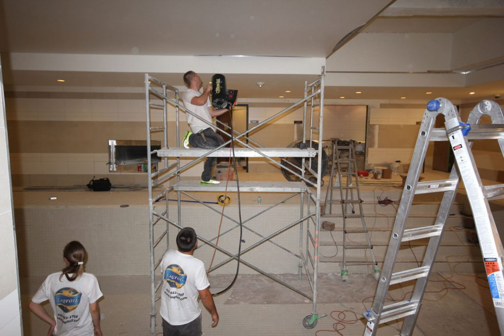 laqfoil team preparing the stretch ceiling for imperial plaza towers toronto