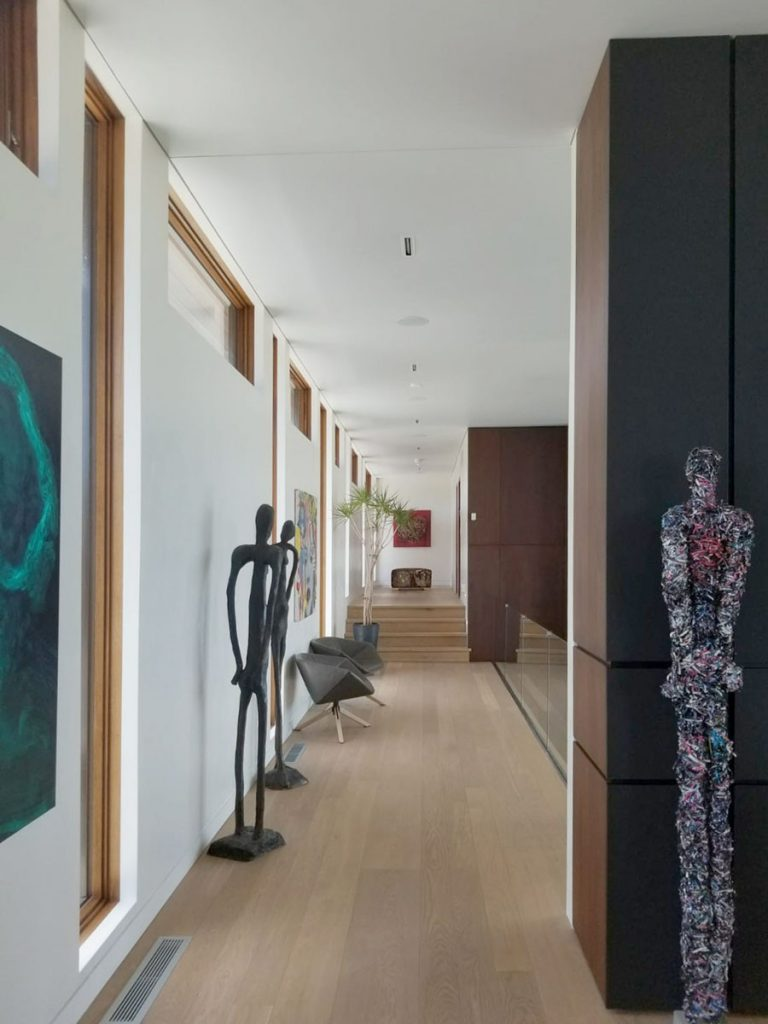modern hallway with stretch ceiling matte in custom home