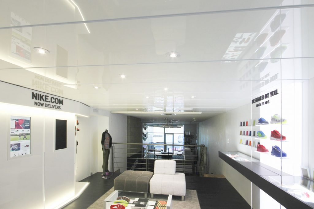 white gloss stretch ceiling with pot lights by laqfoil