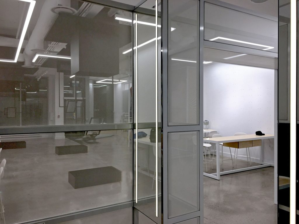 luxury office with glass walls by laqfoil USA