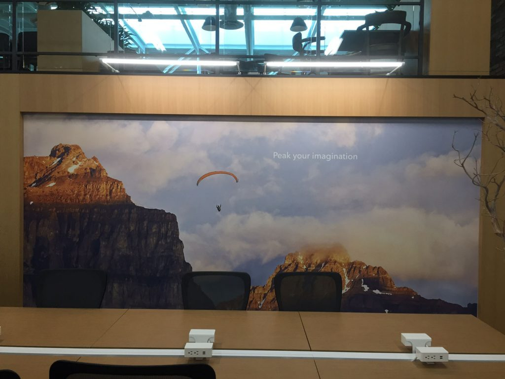man parachuting from a cliff in printed custom wall mural