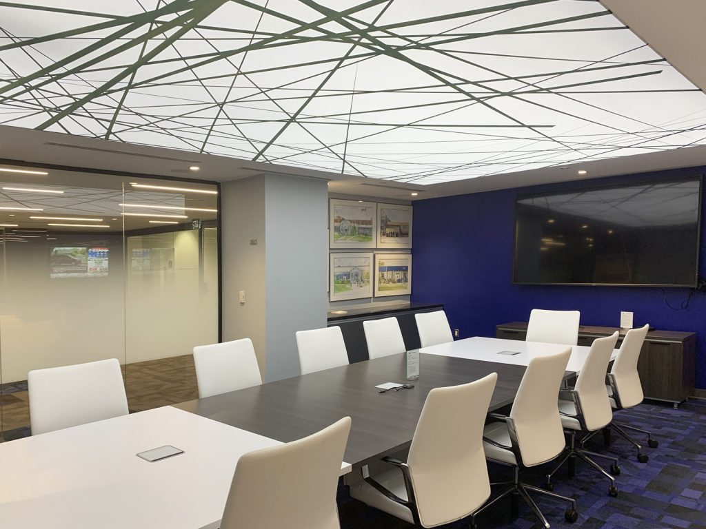 meting room with amazing back lit reflective stretch ceiling