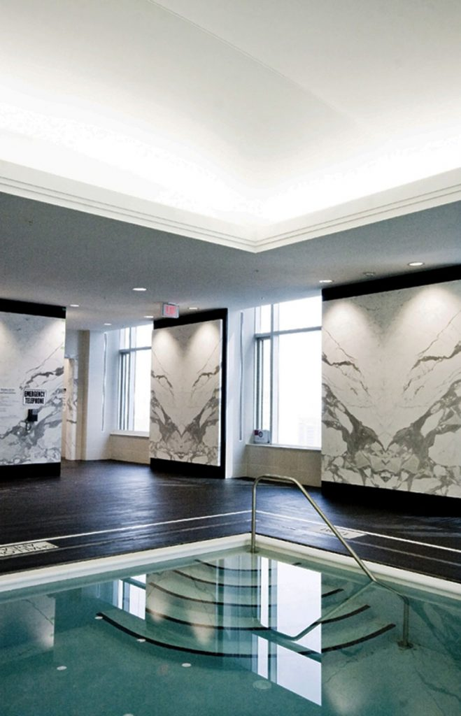 hotel swimming pool with custom wall murals and reflective stretch ceiling Florida