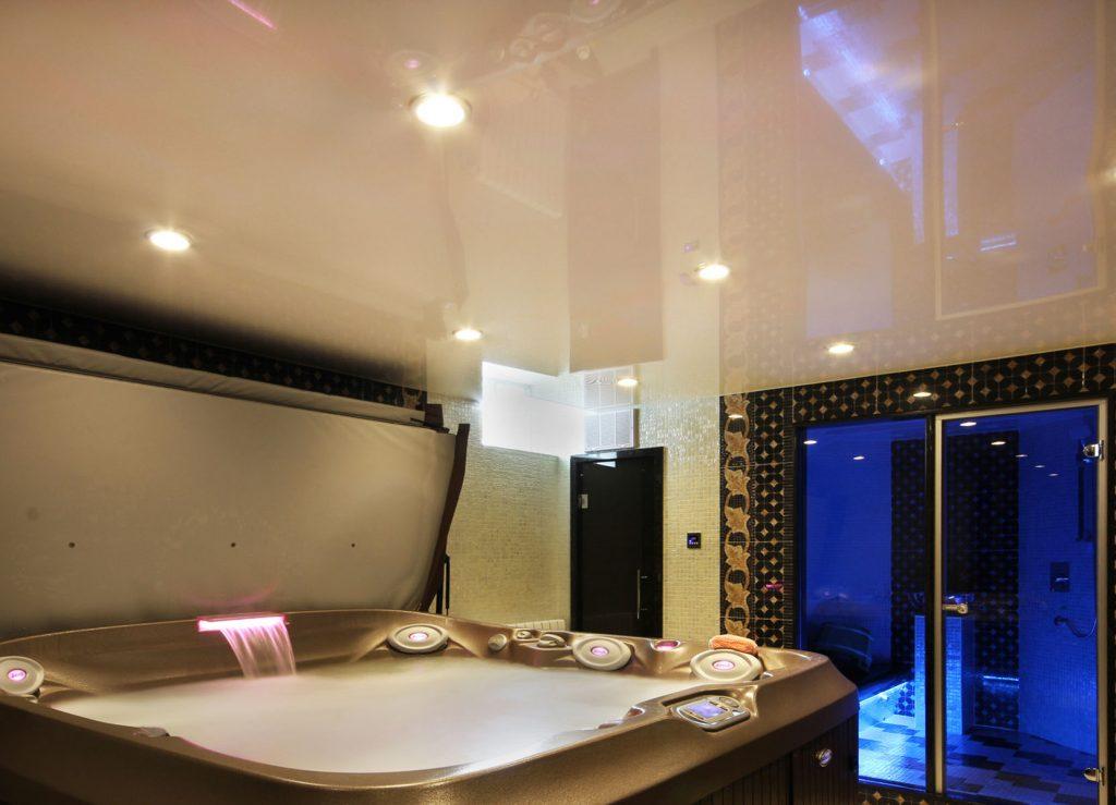 high gloss stretch ceiling in custom jacuzzi bathtub room