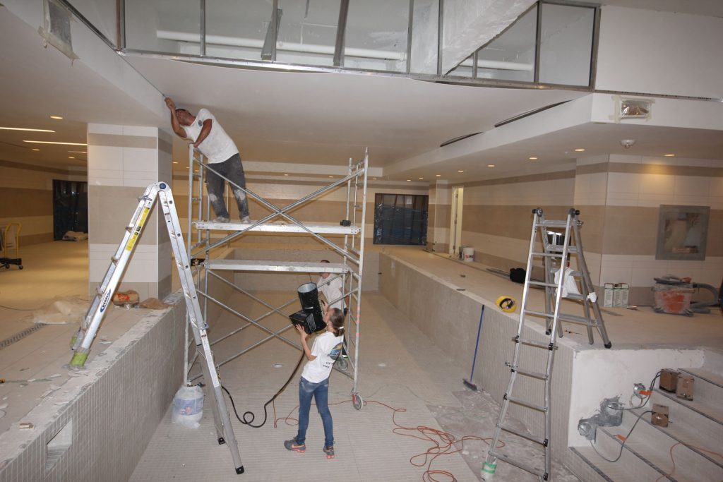 laqfoil team working on installing stretch ceiling