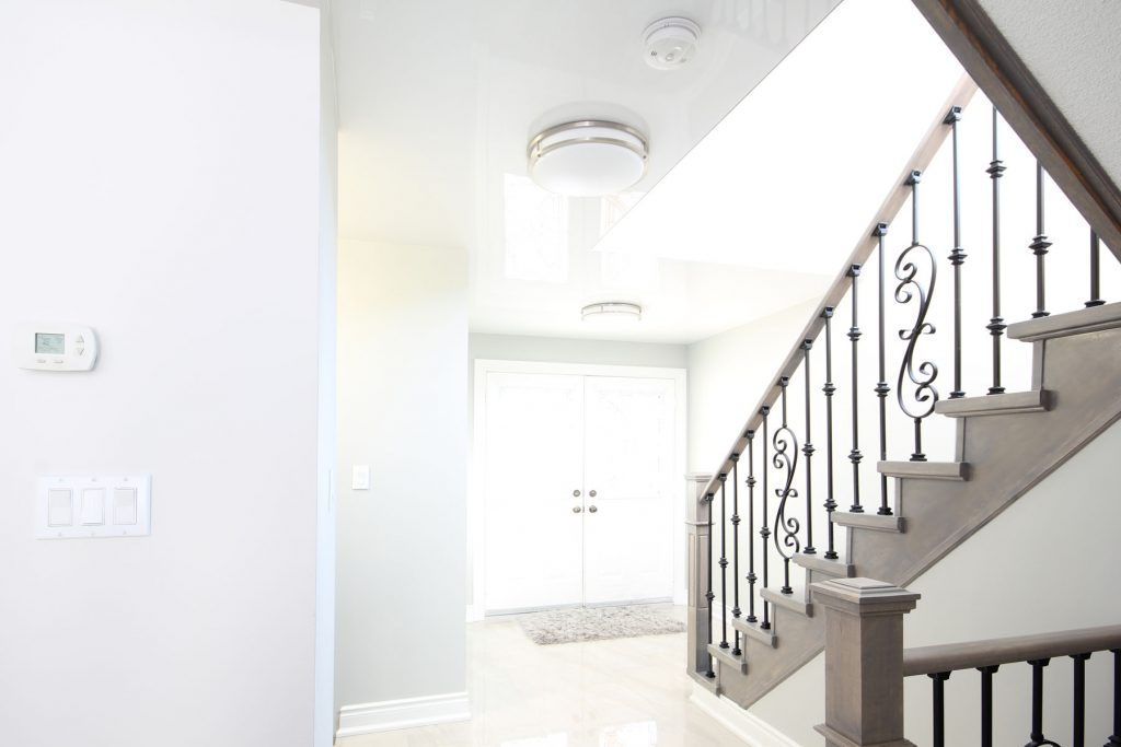 front door hallway with reflective stretch ceiling mumbai