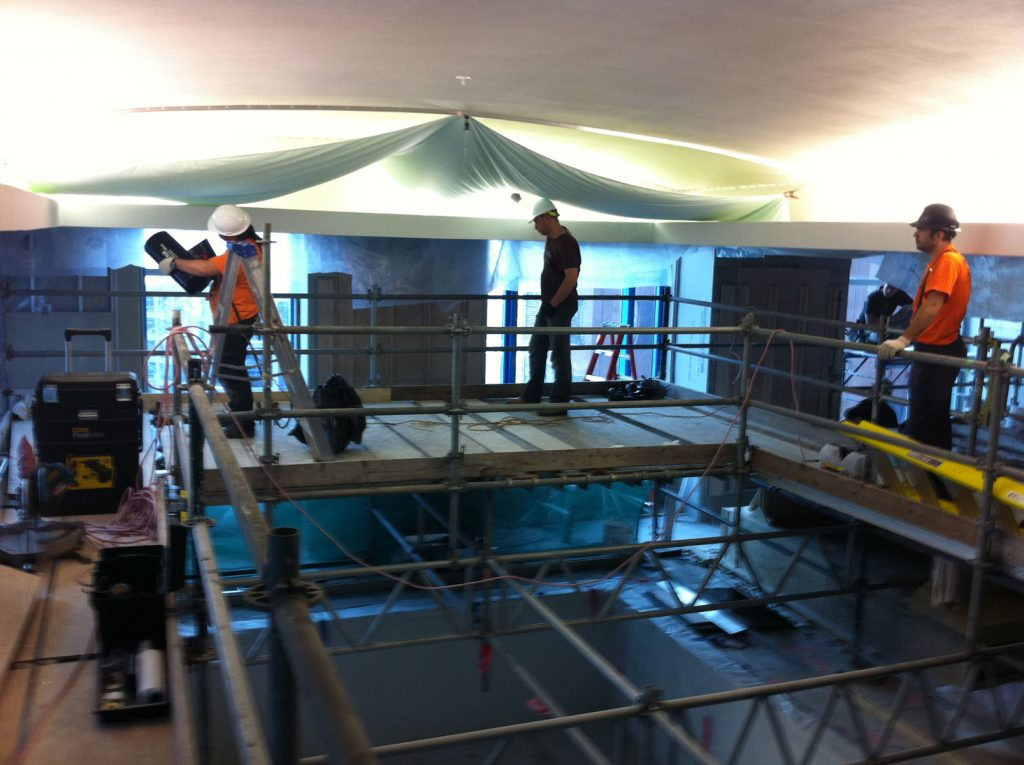 hotel swimming pool area, laqfoil team is replacing the plain ceiling with stretch ceiling