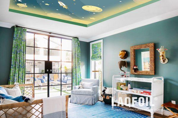 backlit green printed ceiling in kids room