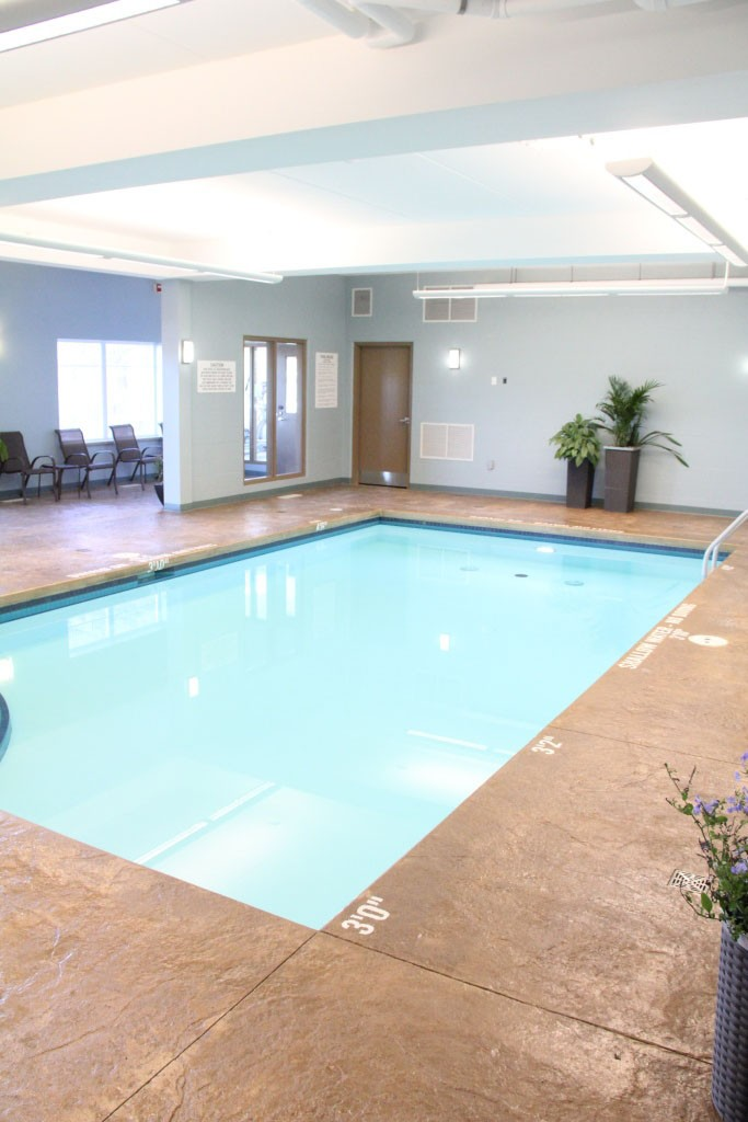 swimming pool with back lit stretch ceiling
