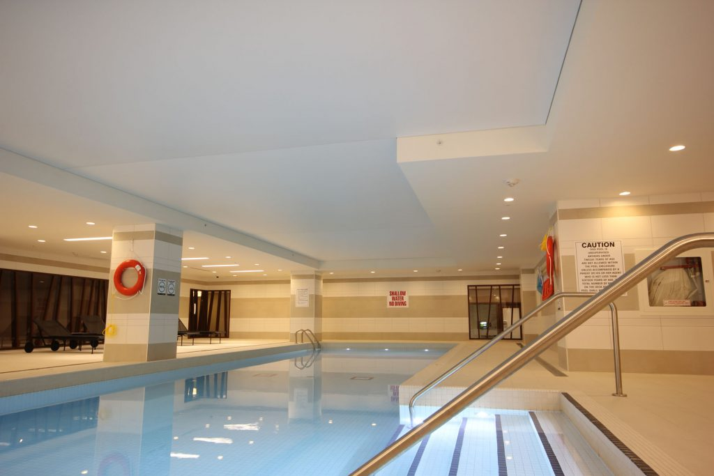 luxury swimming pool area with custom stretch ceiling thailand