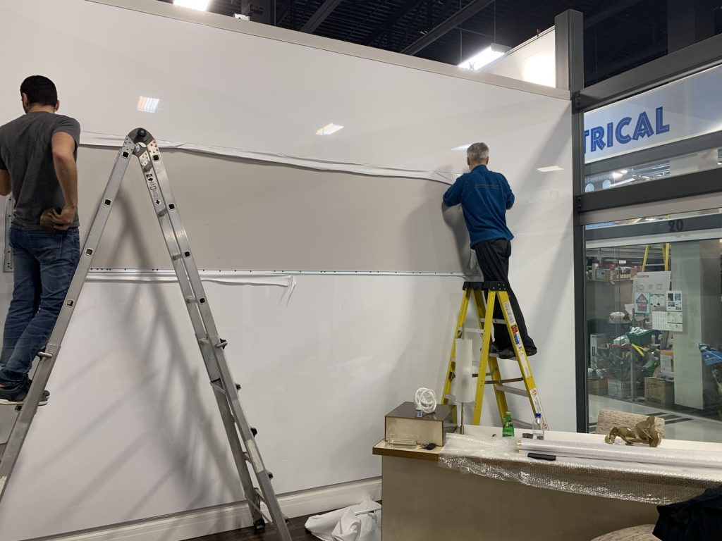 laqfoil team install high gloss stretch fabric on custom wall