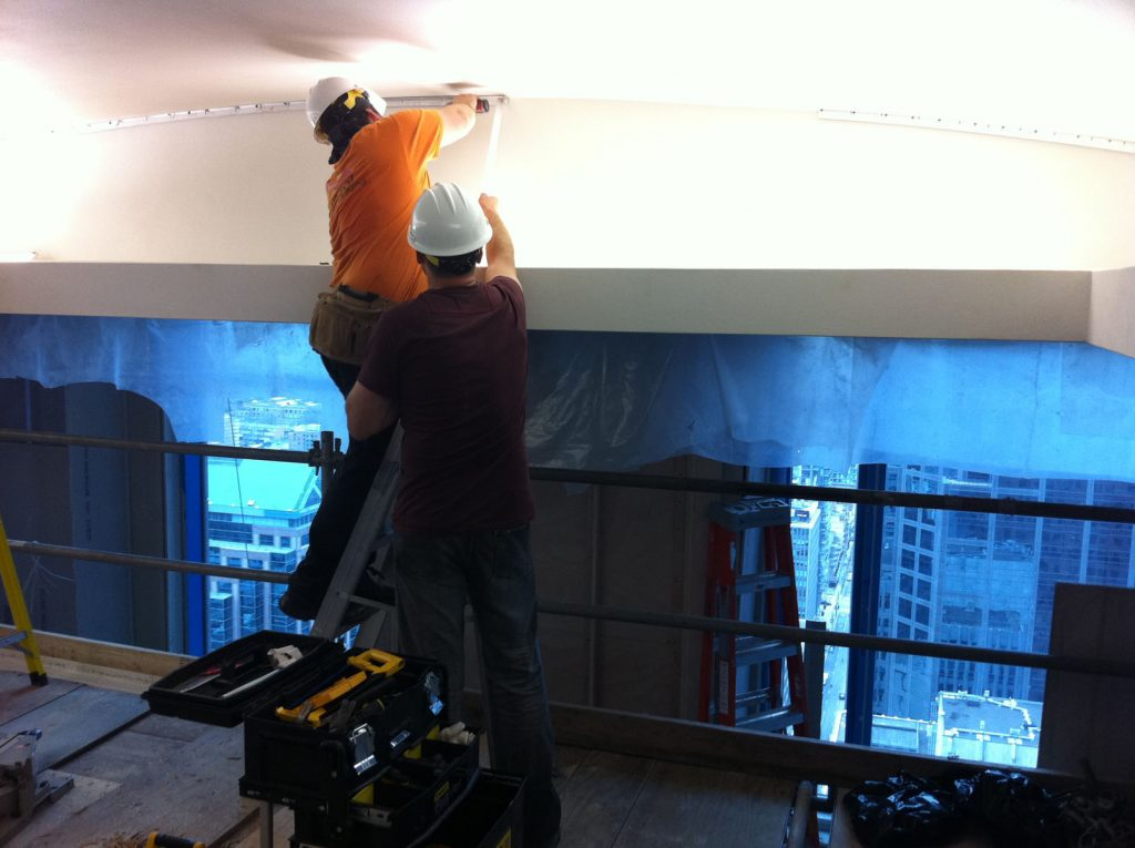 white back lit reflective stretch ceiling installation