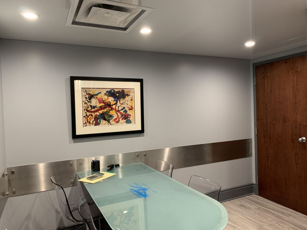 custom office with gloss table and reflective stretch ceiling