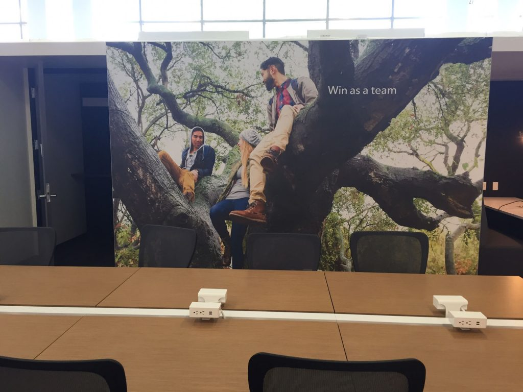 win as a team custom wall cover in luxury rogers open space office