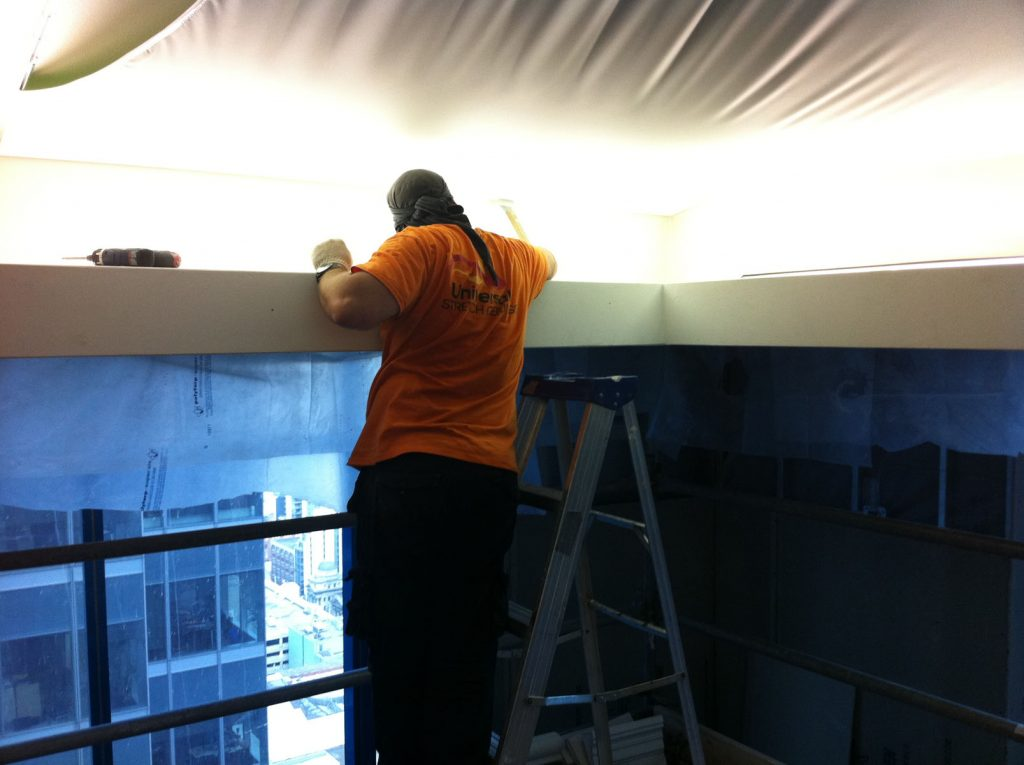 stretching the stretch fabric for reflective ceiling in custom hotel