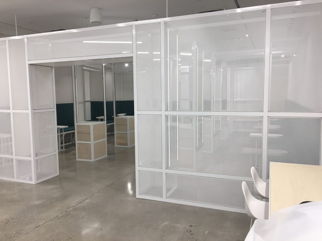 working space white glass walls