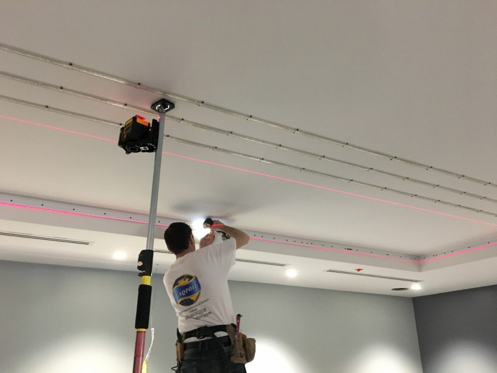laqfoil team preparing ceiling for stretch fabric