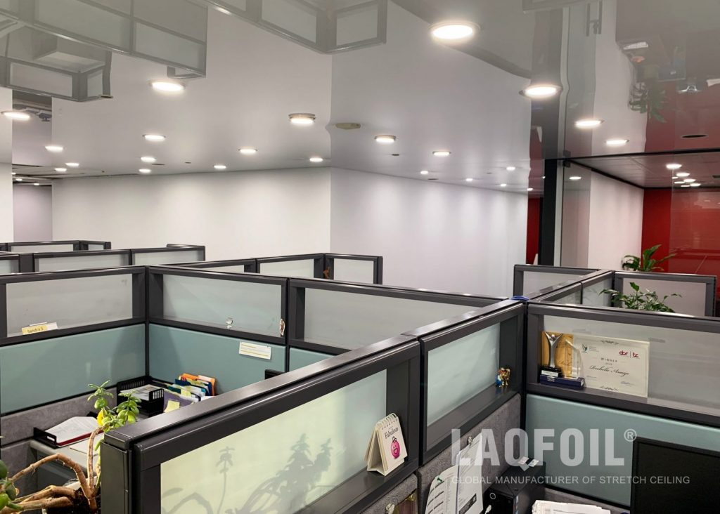 open space office with reflective stretch ceiling