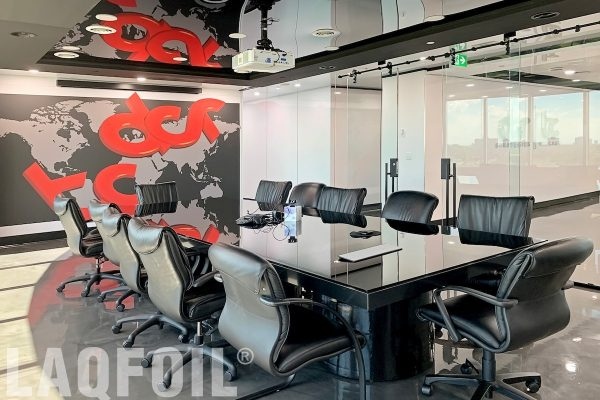 modern meeting room with custom wall mural and reflective black stretch ceiling